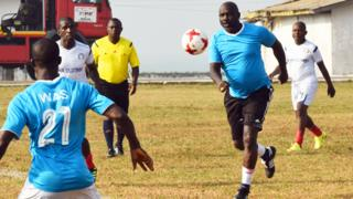 George Weah playing footaball in Monrovia, Liberia