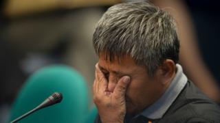 Former death squad member Edgar Matobato gestures as he testifies during a senate hearing in Manila, 15 September 2016