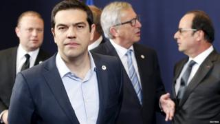 Greece's Prime Minister Alexis Tsipras leaves a family photo next to (back L-R) Malta's Prime Minister Joseph Muscat, European Commission President Jean-Claude Juncker and France's President Francois Hollande