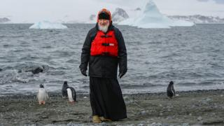 Russian Orthodox Patriarch Kirill is seen near penguins as he visits the Island of Waterloo in the Antarctic, in this handout photo released by Russian patriarchate February 18, 2016