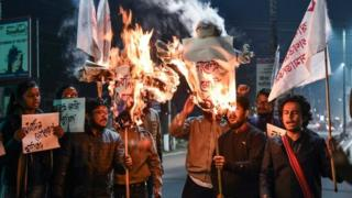 "Activists of Students"" Federation of India (SFI) burn the effigies of India's Prime Minister and Chief Minister of Assam in Guwahati on January 8, 2019 after India's lower house passed today legislation that will grant citizenship to members of certain religious minorities but not Muslims"