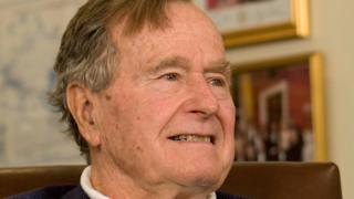 Former President George H.W. Bush smiles as he listens to Republican presidential candidate Mitt Romney speak as he met with Bush to pick up his formal endorsement in Houston March 29, 2012