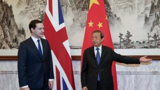 Chinese Vice Premier Ma Kai (R) gestures to Britain's Chancellor of the Exchequer George Osborne
