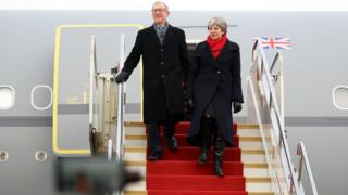 Theresa May and husband Philip arrive at Wuhan airport on 31 January 2018