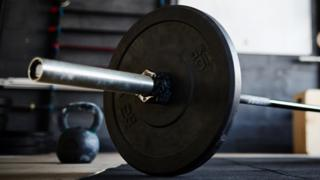 A generic image of a weight attached to a bar