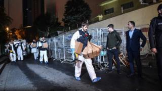 Turkish judicial authorities leave after seeking evidence of the Saudi consulate on October 18, 2018 in Istanbul
