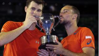"Jamie Murray, left, of Britain and Bruno Soares of Brazil hold their trophy after defeating Daniel Nestor of Canada and Radek Stepanek of the Czech Republic in the men""s doubles final at the Australian Open tennis championships in Melbourne, Australia, early Sunday, Jan. 31"
