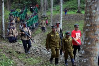 A picture made available on 29 December 2016 shows members of the NPA marching in a forest.