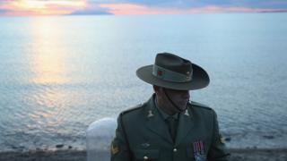 An Australian soldier stands at Anzac Cove in Turkey