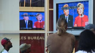 People gather to watch the first US presidential debate