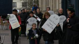 Library protest with gravestones
