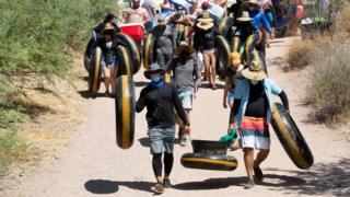 People go tubing on Salt River during the outbreak