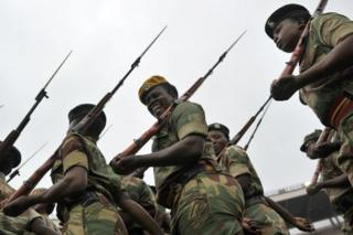 A soldier of the Zimbabwe Defence Force pulls a funny face as she marches in formation during drills to prepare for the inauguration of incoming president Emerson Mnangagwa at the capital Harare's national stadium Zimbabwe's former vice president Emmerson Mnangagwa flew home on November 22 to take power after the resignation of Robert Mugabe put an end to 37 years of authoritarian rule. Mnangagwa will be sworn in as president at an inauguration ceremony on November 24.