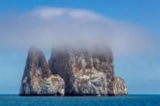 An image of Leon Dormido, or Kicker Rock, taken from Cerro Brujo