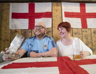 Customers Scott Jones and Laura Jones at the Sawmill Bar in South Elmsall, Yorkshire, where a Brexit party is being held throughout the day ahead of the UK leaving the European Union at 11pm this evening.