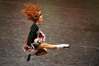 A competitor taking part in the World Irish Dancing Championships at Glasgow's Royal Concert Hall