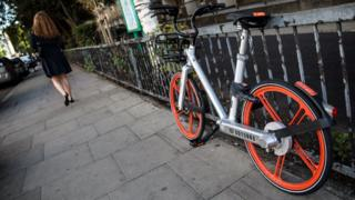A Mobike left against railings