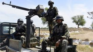 Cameroonian soldiers patrol on November 12, 2014 in Amchide, northern Cameroon, 1 km from Nigeria.