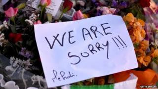 Flowers and tributes are left at Marhaba beach near to where 38 people were killed on Friday in a terrorist attack