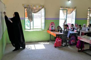 Pupils attend a class on their first day of school in Najaf in central Iraq on 30 September 2019.