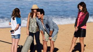 Filming on a beach for Home and Away