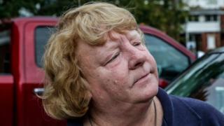 Portrait of Margaret Grassie leaning against car
