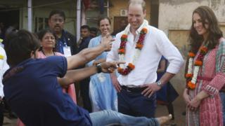 Prince William and his wife the Duchess of Cambridge watch a boy bust a move in Mumbai in India