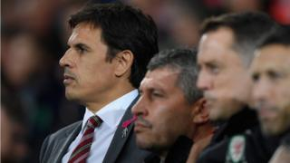 Chris Coleman watches match