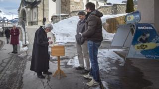 A woman votes in Obersaxen, Switzerland (12 Feb)