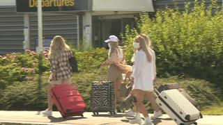 Passengers arrive at the airport for holidays