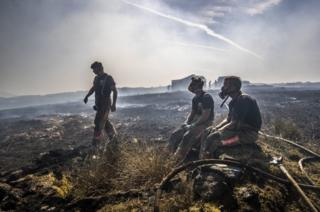 Fire fighters tackle the wildfire on Saddleworth Moor on 28 June 2018.