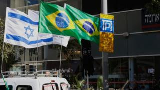 The Israeli and Brazilian flags hanging outside the building housing the offices of the Brazilian Embassy in Tel Aviv