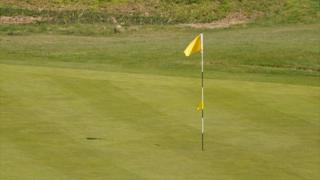 Flag and hole on L'Ancresse golf course