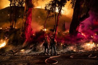 Firefighters work at containing the Maria fire spreading in the hills near Ventura, north-west of Los Angeles, California
