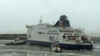 Tugs work to free the ferry in Calais. 10 December
