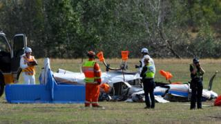 Rescue workers attend one of the planes
