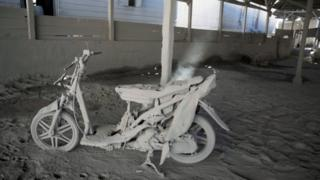 A scooter in a warehouse, covered in volcanic ash, in Gamber village in Karo on 23 May 2016