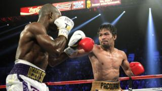 File photo taken on 9 April 2016 shows Manny Pacquiao (right) and Timothy Bradley Jr (left) facing off during their WBO international welterweight title bout at the MGM Grand Arena in Las Vegas, Nevada.