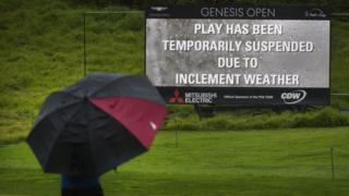 Play at golf course suspended
