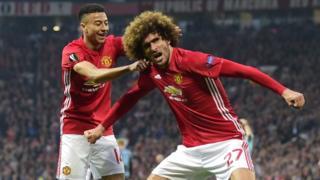 Marouane Fellaini celebrates after scoring in the Europa League semi final
