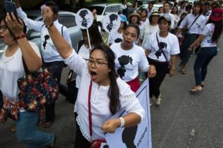 "Protesters walk to the Central Investigation Department (CID) during the demonstration demanding justice for a two-year-old who was raped and given the pseudonym ""Victoria"" in Yangon on July 6, 2019."