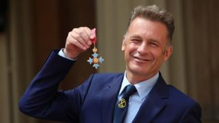 Chris Packham with his CBE medal