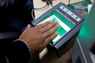 A woman goes through the process of finger scanning for the Unique Identification (UID) database system, also known as Aadhaar, at a registration centre in New Delhi, India, January 17, 2018.