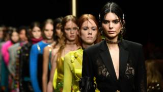 Model Kendall Jenner and others in a Versace fashion show in 2019 in Milan