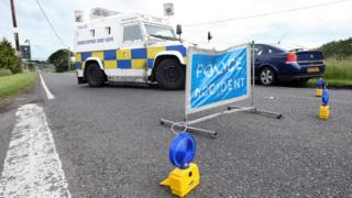 Police vehicles at the scene of a road traffic collision