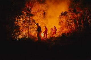 Volunteer firefighters start a controlled burn in Australian bushland