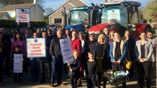 A protest, with tractors, outside Lixwm Primary