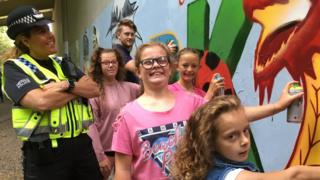 Kids painting the mural on the underpass in Pontypridd
