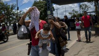 Venezuelan migrant walks out the Brazilian immigration point in the border city of Pacaraima, Roraima, Brazil, on August 20, 2018