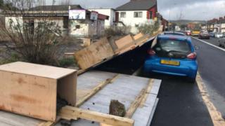 A fence falls onto a car in the Birchgrove area of Cardiff